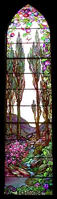 """Lewis Comfort Tiffany was at his best with landscapes and introduced landscape windows into churches (as well as homes) just after the turn of the century.  Especially notable in the window is the """"confetti glass, which adds depth, texture and interest to the landscape."""