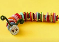 Button caterpillar :) Thread buttons onto a folded pipe cleaner then add a happy face