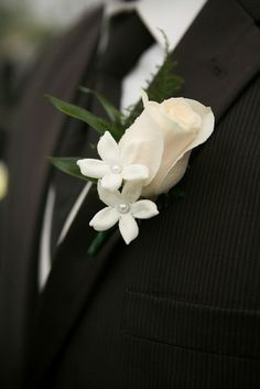 White rose and stephanotis with pearl centers boutonniere