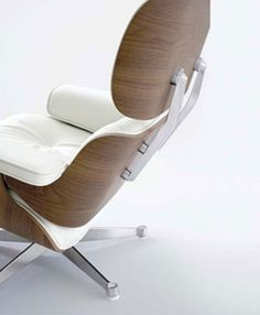 The famous Lounge Chair by Charles and Ray Eames in the updated Hella Jongerius version with white leather, white pigmented walnut shells and polished alumnium. Want!