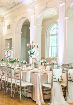 Estate table florals, linens and lighting by Stems. Beautiful wedding at the Biltmore Ballrooms featuring blush, peach and champagne with accents of greenery