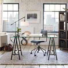 besides loving the style of this loft: brick walls & wood floor... i love the glass top & the legs on this desk