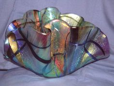 Colorful glass bowl with soft iridescent pastel colors