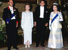 1982 from Queen Elizabeth II's Royal Style Through the Years  Queen Elizabeth II wore a blue satin gown while meeting with then-president Ronald Reagan and his wife Nancy Reagan at Windsor Castle.