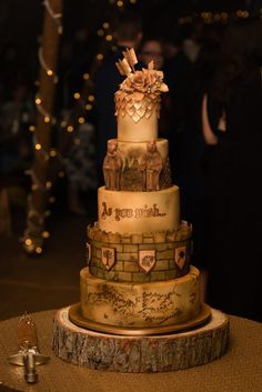Lord of the Rings/Game of Thrones themed wedding cake by Immaculate Confections. @ImmacConfecUK #weddingcake #lotr #gameofthrones #themedwedding