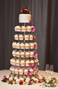 cupcake wedding cake. I'm not sure how I'd feel about this at my wedding.. But I would love it at someone else's :)