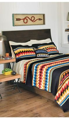 love the blanket and the arrow artwork...PENDLETON Suwanee Stripe Blanket Collection