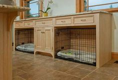 Built in dog crates in mud room.