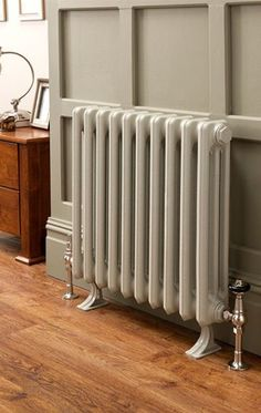 Priory 3 column 10 sections 480mm high, painted in RAL 7032 Pebble grey, shown with Chrome Buckingham TRV valves and cast feet.