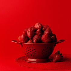 Red strawberries monochromatic still life