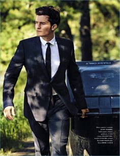 Suiting up, Orlando Bloom wears a sharp look from Dior Homme.