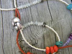 Beautiful mix of stones with antique sterling button by juRnE, $35.00