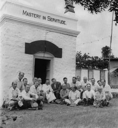 Meher Baba with Western Men Mandali outside early tomb-site.