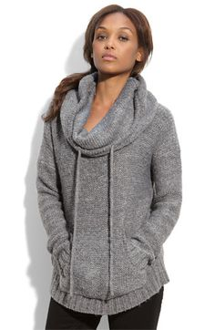 A cozy sweater-knit pullover is topped with a slouchy, slightly cowled neck cinched by a tonal drawstring.