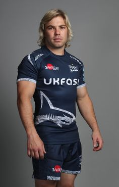 Faf de Klerk Photos - Faf de Klerk poses for a portrait during the Sale Sharks squad photo call for the Gallagher Premiership Rugby season at AJ Bell Stadium on August 2018 in Salford, England. Rugby Poster, Squad Photos, Salford, Childhood Memories, Sharks, Sporty, Poses, Seasons, Portrait