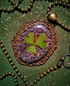 Clover and poppy flower resin necklace