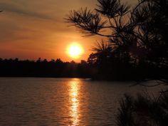 Sunset over Lake Kawaguesaga by Ken Groezinger