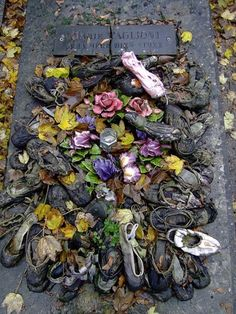 The grave of ballerina Marie Tagioni at the Montmartre cemetery in Paris, where young dancers still leave their dancing shoes and flowers. Marie Taglioni pioneered the en pointe style of dance which characterizes ballet today.