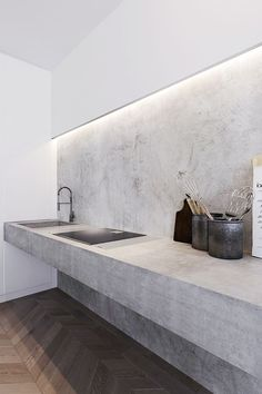 Exposed stone in the bedroom, chevron floors, concrete kitchen and ultra modern bathroom … the interiors of this loft apartment in Moscow is a clever 3D design by Ira Frolova, architect and designer …
