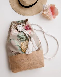 Tropical floral pineapple and jute burlap back pack duffle bag a tropical floral print of happy pineapples and soft pink hibiscus flowers covers this fun beach ready backpack the colors in this print are light and lovely pale khaki baby blue blush pink if My Bags, Purses And Bags, Diy Sac, Fabric Bags, Summer Bags, Handmade Bags, Fashion Bags, Straw Bag, Burlap