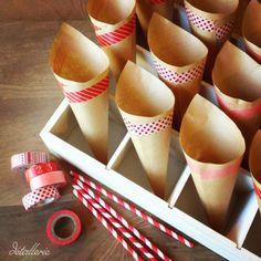 Conos para palomitas en una fiesta de tematica de circo. Circus party. Children party. Pop corn cones. Craft. Washi tape decoration. Decoration with red and white.