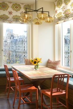 Spruce Interior Design - Interior Designer - New York - Contemporary - Modern - Eclectic - Moroccan - Kitchen - Bright - Printed Table - Bold - Colorful - Orange Chairs - Wood Floor - Window Bench - Pillow - Printed Blinds - Lighting - Chandelier - Glass Globe Lights - Yellow - Orange - Sunny