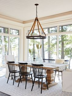 windsor chairs, bench on one side, large dining table, slip covered head of table.