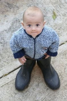 Aww... What a cute photo idea :) reminds me of my son in his daddy's huge cowboy boots when he was little!