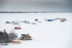 Houseboats dotted the frozen surface of Great Slave Lake in Yellowknife, the capital of the Northwest Territories. Credit Christopher Miller for The New York Times Ice Fishing Huts, Fly Fishing, Women Fishing, Fishing Rods, Fishing Tackle, Kodiak Island, Canada Travel, Canada Trip, Northwest Territories