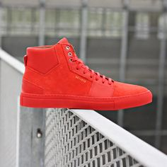 Axel Arigato red high top sneaker with a minimalistic design, handcrafted with premium Italian materials. #axelarigato #sneakers #mensfashion