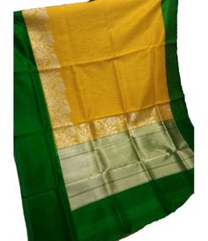 Yellow Banarasi Handloom Katan Silk Saree----------------------------------------------------------------Banarasi sarees are among the best and finest sarees in India. They are well known for their intricate weaving style using silver, gold and Zari threads. It is made using the finest silk. ----------------------------------------Sarees from Luxurionworld