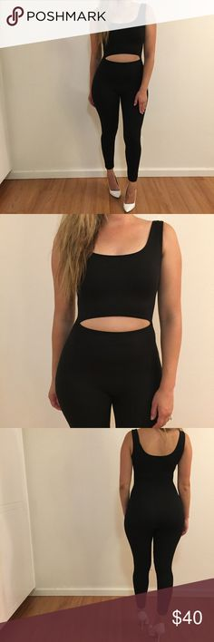 """🆕 Cut Out Black Tank Jumpsuit The perfect cut out black tank Jumpsuit. Super stretch and skinny. Cut out detail. True to size. Model is wearing a small.  Model is 5'5"""" for reference. 92% polyester, 8% spandex. No trades. Available in S, M, & L. Pants Jumpsuits & Rompers"""