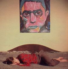 David Bowie sleeping in front of his painting of Yukio Mishima.