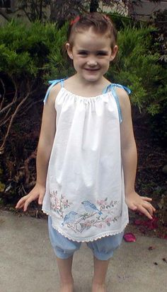 Another pillowcase dress/top.  Looks like they used an embroidered vintage pillowcase. Cute!  And an adorable model too.