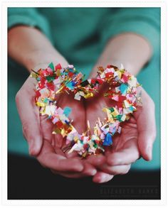 DIY hot glue confetti heart - these would be cute for a wedding (seating cards, napkin rings, etc.)