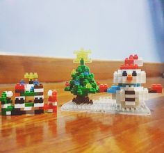 It's christmas and here comes a snowman with an xmas tree..new addition to the nanoblock collection.. #lego #nanoblock #bricks #toys #toy #collection #display #creative #art #perspective #christmastime #christmas #tree #snowman #party #light #carrot #star #japan #home #handmade #myself #cute #fun #photo #photooftheday #enjoy #lifestyle #sg #wanderlust