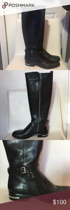 Michael Kors Riding Boots Black knee high leather boots, silver hardware, adjustable side buckle, side zipper for entry. New condition, worn once only for try on. No scratches or marks. Beautiful leather, non slip bottoms. Feels true to size. Excellent condition. Doesn't come with box. Michael Kors Shoes