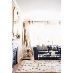 simply elegant living room. blue sofa and southwest rug