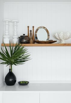 Rustic wooden decor on shelf in white coastal kitchen. How To Become An Interior Designer, White Coastal Kitchen, Mission Style Homes, Bathroom Design Inspiration, Sleeping Loft, Tiles Online, Buy Chair, Beach Shack, Level Homes