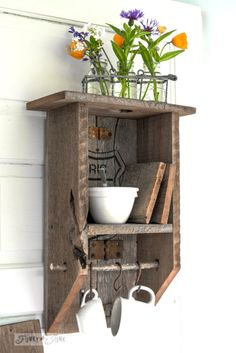 #4. Reclaimed wood shelf with branch cup hangers / 6 ways to make a vintage coffee station... upcycled style! By Funky Junk Interiors for ebay.com