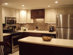 ours two tone kitchen cabinets stainless appliances quartz