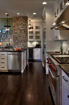 Eye Catching Stone Columns give this cooking zone it's intriguing character | by diyannicon