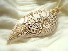 White Lace Texture Pendant Polymer clay Handmade Jewelry. $24.00, via Etsy.