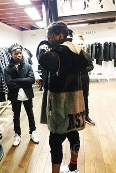ASAP Rocky wearing  Astrid Andersen FW14 Fur Zip Off Coat, Y-3 Qasa Racer