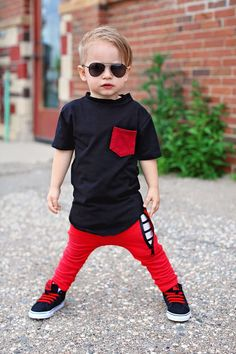 Our joggers are perfect for your hipster baby or hipster toddler who like to stand out! * Soft and comfortable Red drop crotch zipper joggers * Red zipper pocket in the front * Red vertical pocket on the back (Right side) * Monochrome stripe pocket lining * Size is comparable to our