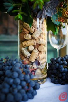 Corks in vase. This would be a pretty centerpiece for a dinner party.