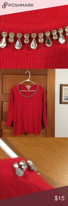 Vintage jewelry red sweater This sweater has the most beautiful neck line of Crystal  jewelry See photos. They shine like diamonds. This sweater is being sold as is and more for the jewels then sweater.. It has one missing  jewel ,see photos. If someone is handy they could remove the one on the back shoulder and put it in its place. Or take all the jewels I make a gorgeous necklace. Any artsy people out there? Vintage by Cathy Daniels. vintage Sweaters Crew & Scoop Necks