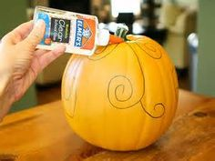 draw a design on a pumpkin put glue on and sprinkle with glitter....would be SO pretty