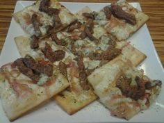 Steak flatbread with blue cheese, mozzarella, and candied onions