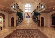 Mediterranean Staircase with Arched window, complex marble floors, Custom wrought iron stair railing, Double staircase